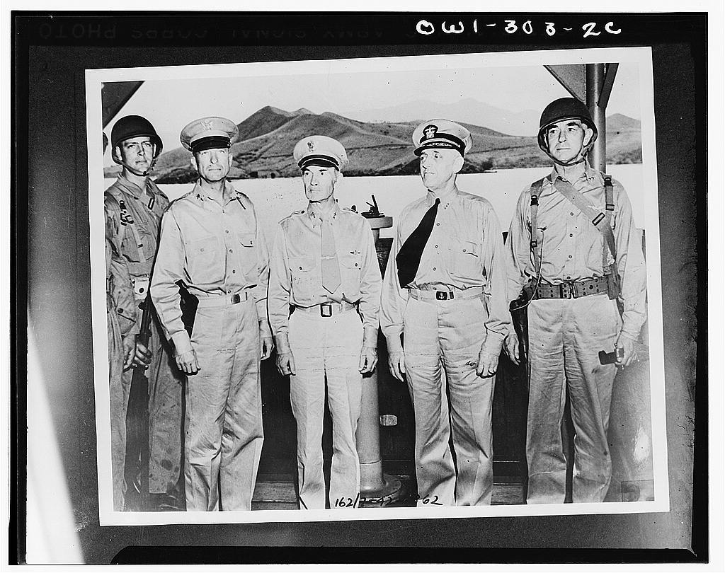 Major General Alexander M. Patch, Jr., commander of the United forces in New Caledonia; Major General M.F. Harmon, commanding Army forces in the South Pacific area; Vice Admiral Robert Lee Ghormley; and Rear Admiral Kelly Turner, who conducted the inspection of the troops dispatched from New Caledonia to join the Marines in the Solomons