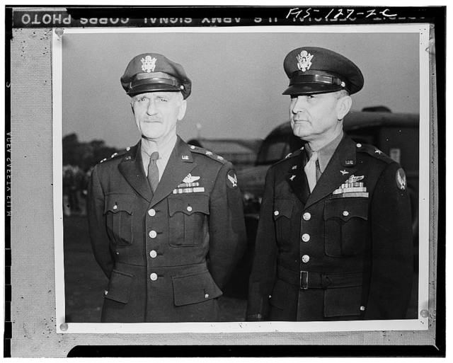Major General Carl Spaatz, commanding general Air Forces, Etousa, of Earlville, Pennsylvania, and Brigadier General Ira C. Eaker of Lane County, Texas, as they awarded decorations to airmen in Britain
