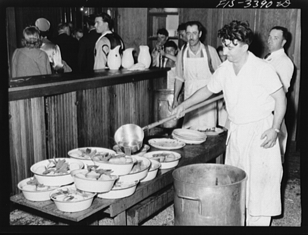 Making the soupa for dinner at the Festival of the Holy Ghost, Novato, California. Soupa is one of the special dishes of the Portuguese-Americans and consists of spiced gravy poured over sliced bread with big sprigs of fresh mint