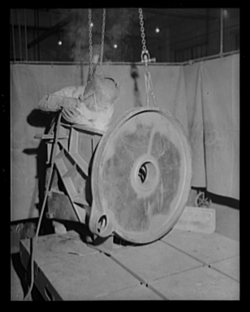Making the sparks fly. The welding machine glows brightly as a worker in an eastern arsenal attacks a fabricated structure for the 90 mm gun anti-aircraft carriage