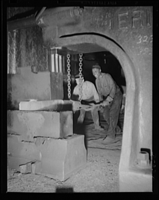 Mammoth weight of drop forger. Forging part of a large gun in an eastern Navy yard, one of eleven arsenals which have stepped up production to top speed for the war program