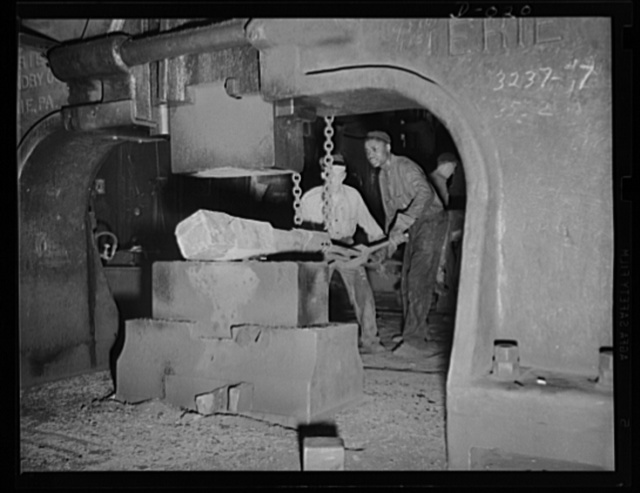 Mammoth weight of drop forger. Forging part of a large gun in an eastern Navy yard. This is one of eleven Navy arsenals which have stepped up production to top speed for the war program