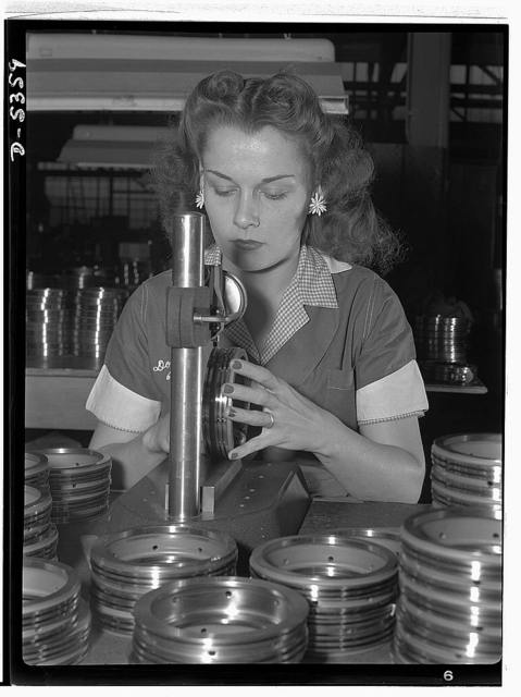 "Manpower. Former actress now aircraft worker. From central casting to aircraft casting! Erstwhile child star of the silent picture days, auburn-haired Dorothy Langdon now inspects airplane engine parts in a Detroit war plant. Known as ""Baby Dorothy Phelps"" of the silents, and heart interest of western thrillers in the middle thirties, Miss Langdon joined America's army of women war workers early this year. With a husband in the Army, the twenty-six-year-old beauty finds her new role in life eminently satisfying. ""I'm really doing something,"" she says. ""I got tired of just playing at doing something."" In addition to her forty-eight hour work week at the inspection table, Miss Langdon still finds time to study drafting at night"
