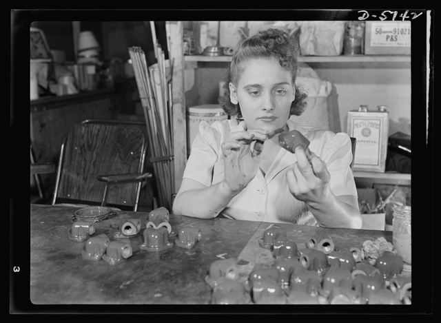 Manpower. Handicapped workers. With both arms and legs crippled by infantile paralysis, pretty Mary Elizabeth Conway, twenty-one, does a war job for Uncle Sam, and loves it. She's painting Y's for airplane engines at the Maryland League for Crippled Children, working on a contract to a Baltimore engineering company. White Engineering Company, Baltimore, Maryland