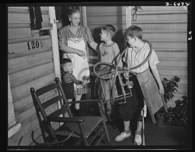 Manpower, junior size. Door-to-door salesmen for their Uncle Sam, these Roanoke, Virginia youngsters are scouring the neighborhoods for scrap metal and rubber which will be processed into vital war materials