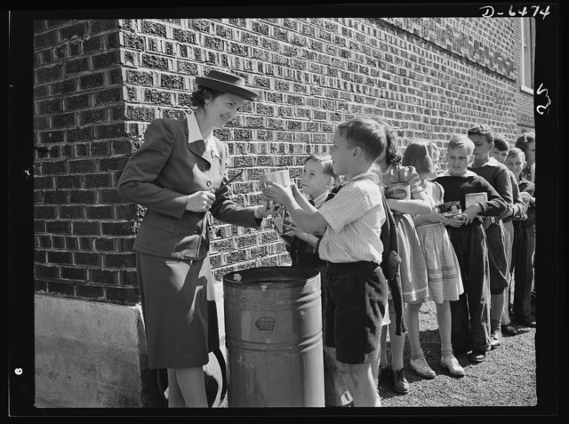Manpower, junior size. Saturday's a holiday for most of the nation's small-fries, but to these youngsters of Roanoke, Virginia, it's fat collection day. As part of their junior commando activities, these boys and girls collect all fats and greases from local housewives during the week, and turn it over to school authorities on Saturday. From here, the fats are sent to a rendering plant where precious glycerin will be derived from it