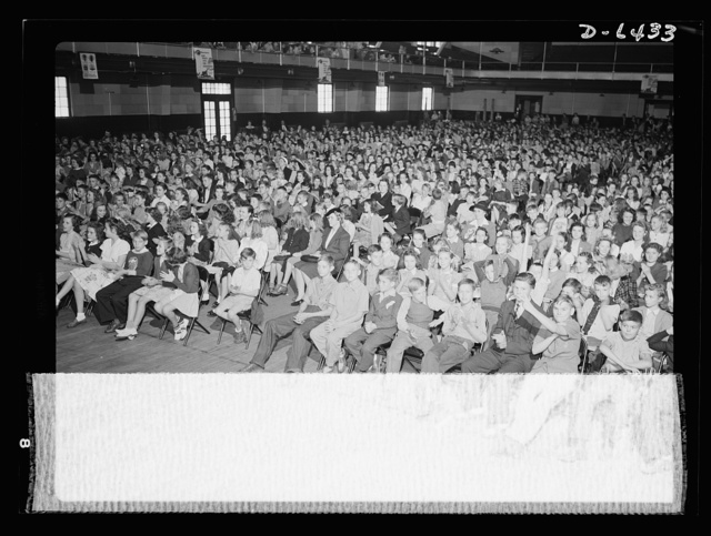 """Manpower, junior size. The third front--unified, enthusiastic, patriotic--banded together where there are no sides but """"our side."""" School children in Roanoke, Virginia listened eagerly as speakers explained to them the work of the junior commandos"""