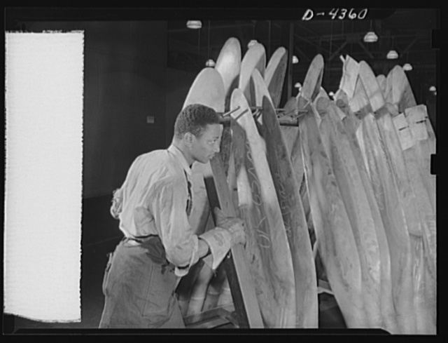 Manpower. Negro aircraft propeller workers. A batch of propeller blades is rushed from one operation to another by one of the many Negro workers in a large Eastern airplane propeller plant. Curtiss-Wright Propeller Division. Caldwell, New Jersey