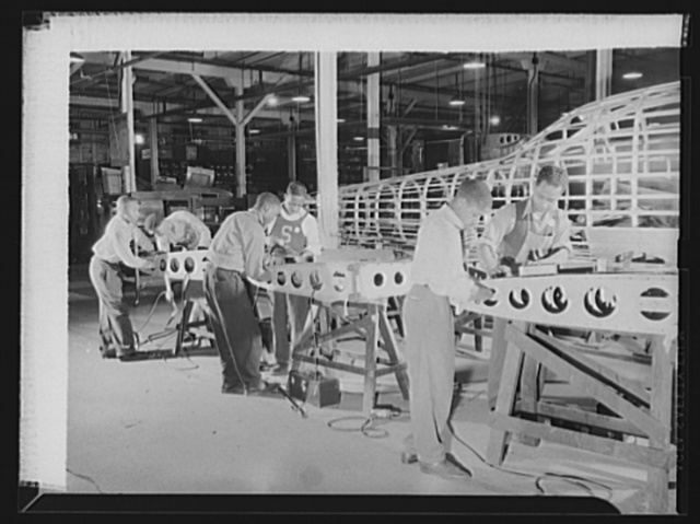 Manpower. Negro bomber plant workers. Negro graduates of war training course are shown attaching skins to the fins of medium bombers in a large Eastern aircraft plant. Glenn L. Martin Bomber Plant. Baltimore, Maryland