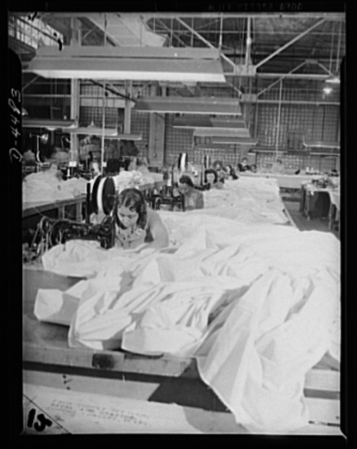Manpower. Negro navy yard workers. So that America's paratroopers may write history in this new field of modern warfare, these women workers in the aircraft factory of an Eastern navy yard are turning miles of silk into parachutes for our armed forces