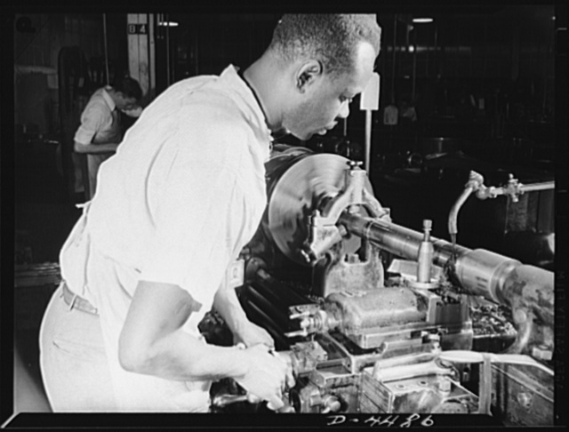 Manpower. Negro navy yard workers. Thomas Walker, one of the many Negro workers employed in the aircraft factory of a larger Eastern navy yard, contributes to the happy landings of our air warriors. Walker is shown working on olios, a part of the landing gear of fighting craft