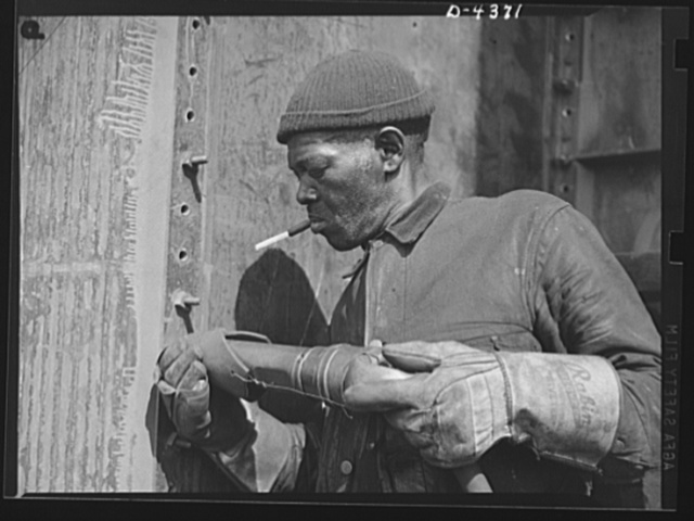 Manpower. Negro shipyard workers. Skills which contributed to America's success in World War I are vital to our efforts in World War II. This Negro riveter is a veteran employee in a large Eastern shipyard. Another Negro broke the world record for riveting in World War I. Federal Shipbuilding and Drydock Corporation. Kearny, New Jersey
