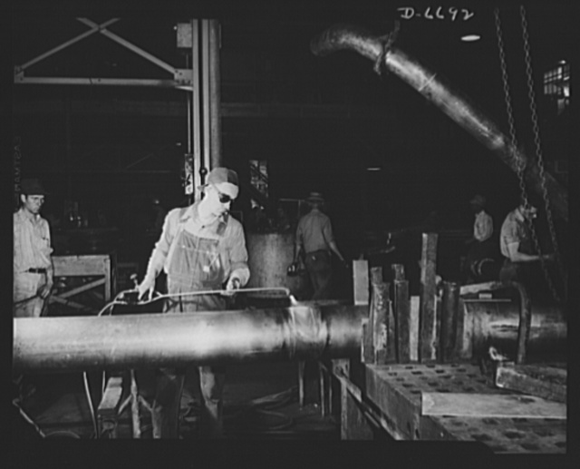 Manpower. Southern shipyard workers. A grocery store manager for thirteen years, C.R. Summers now is a sheet metal worker in a Southern Navy yard. Following a short training course in this work, he became adept at the job shown here, brazing on the sleeves that join lengths of copper tubing for Navy vessels