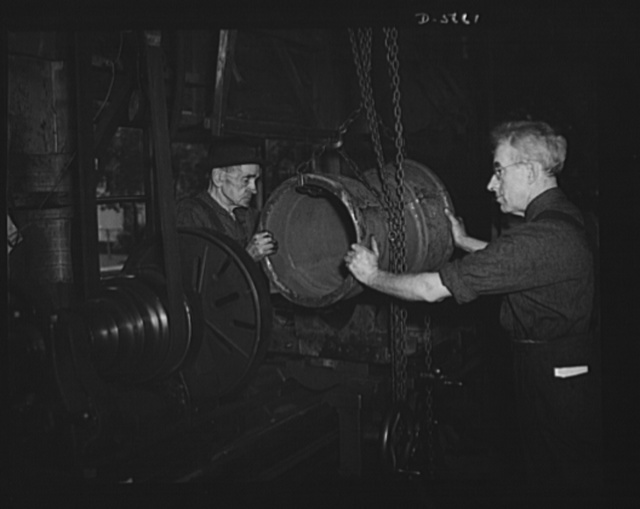 """""""Me and the old gent."""" """"The old gent and me"""" form the only two-man labor-management war production drive committee in the United States. Jake Sparling Pulley Manufacturing Company at Bay City, Michigan, and his helper, seventy-nine-year-old ex-lumberjack Percy Fogelsonger, were cited by Donald Nelson and named to head the list of 1,300 plants enrolled in the War Production Drive. They work fifteen hours each day, seven days a week, and produced 18,000 steel flanges for war equipment in eighteen months"""