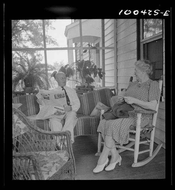 Mechanicsville, Maryland. Mr. and Mrs. Charles Herbert sitting on the porch of the home which he helped to build when he first came here thirty-six years ago to be a express agent. Mrs. Herbert is the town dressmaker