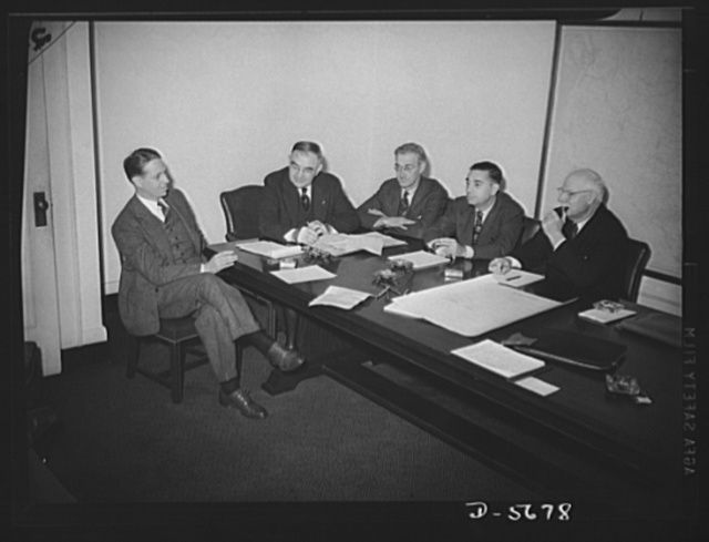 Meeting. Consultant Board of Smaller War Plants Division. Meeting of the Consultant Board of the Smaller War Plants Division in Washington, October 23,1942, to assist in forming policies and to advise on problems relating to production orders, facilities, labor and finance. Board members are, left to right: Stanley A. Carlson, Howe Machinery Company, Passaic, New Jersey; Lou E. Holland, Holland Engraving Company, Kansas City, Missouri; W.B. Stout, Stout Manufacturing Company, Detroit, Michigan; W.B. Connell, West Side Machine Works, Kansas City, Missouri; George Trundle, Trundle Engineering Company, Cleveland Ohio