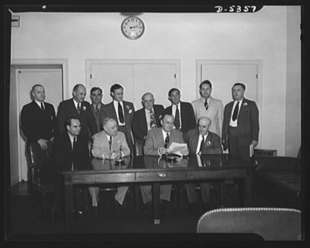 Meeting of policy committee with the War Production Board and labor officials. Meeting of the WPB's policy committee, made up of three high officials from each of the major labor organizations, with the WPB and labor officials. Left to right, seated: William L. Batt, Vice Chairman, WPB; William Green, President, American Federation of Labor (AFL); Donald Nelson, Chairman, WPB; and Phillip Murray, President, Congress of Industrial Organizations (CIO). Left to right, standing: George Masterton, President, United Association of Journeymen Plumbers and Steamfitters, AFL; Clinton S. Golden, Assistant to President, United Steel Workers of America, Congress of Industrial Organizations (USWA-CIO); Joseph D. Keenan, Associate Director, Labor Production Division, WPB; Victor Reuther, CIO; Joseph S. McDonoagh, AFL national headquarters; Frank P. Fenton, Director of Organization, AFL;  Wendell Lund, Director, Labor Production Division, WPB; and Philip Clowes, Associate Director Labor Production Division, WPB