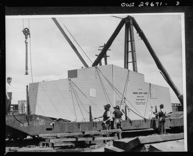 Melbourne, Australia. Beaufort torpedo bomber rear fuselage and tail sub-assembly plant. Specially constructed container and truck for transporting major components from sub-assembly plants to main assembly plant