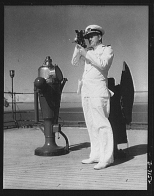 """Merchant ship officer. """"Shooting the sun"""" with his sextant, this deck officer on a merchant ship typifies the highly competent manpower handling the movement of materials from the home front to the battle front"""