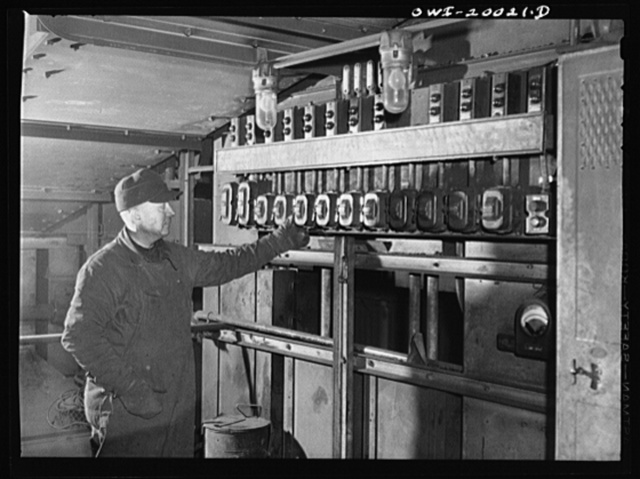 Milwaukee Western Fuel Company, Milwaukee, Wisconsin. Most of the work at the coal docks of the Milwaukee Western Fuel Company is mechanized. This control board is located on top of the processing plant. From here the men control the flow of coal into the hoppers, the speed of the sizing machines, the movement of the belts in the tunnel, and all the chutes in the plant