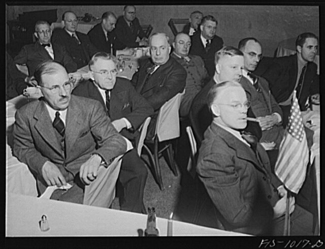 Minneapolis, Minnesota. Members of the Swedish Club listening to a lecture by Elmer Peterson, Minneapolis radio commentator. On the extreme right is Mr. Hugo Seashore from Sjostrand. Mr. Seashore was born in Halmstad, a province of Halland, Sweden. He is superintendent of a type of setting company in Minneapolis. In his younger days he was a light heavyweight prize fighter. On the left is Mr. Gust Roos, an interior decorator. Mr. Roos was born in Umeo, near the city of Vestros, province of Vestmanland, Sweden, and came to this country when he was twenty-seven years old