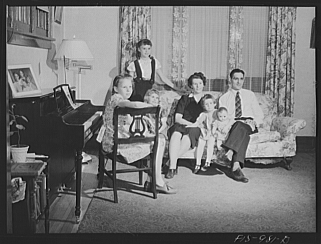 Minneapolis, Minnesota. Mr. Arthur Sven Brink and his family. Mr. Brink is a welder at an important war factory in the Minneapolis area. He lives in a medium-sized house with his wife Hilda and their four children: Mary Jane, four, Gloria, seven, Caren, ten, and Ruth, twelve. Mr. Brink was born in Skara, province of Vesterjutland, Sweden. His wife was born in Minnesota, but her father came from Vastmanland and her mother from Varmland. They have been married thirteen years and have lived in Minneapolis all that time. Mr. Brink goes to work at six o'clock in the morningand his earnings average ninety dollars per week. He has been a welder for fifteen years and has been on his new job for two months