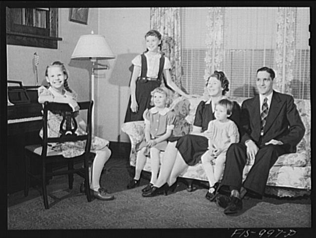Minneapolis, Minnesota. Mr. Authur Sven Brink and his family. Mr. Brink is a welder at an important war factory in the Minneapolis area. He lives in a medium-sized house with his wife Hilda and their four children: Mary Jane, four, Gloria, seven, Caren, ten, and Ruth twelve. Mr. Brink was born in Skara, a province of Vesterjutland, Sweden. His wife was born in Minnesota but her father came from Vastmanland and her mother from Varmland. They have been married thirteen years and have lived in Minneapolis all that time. Mr. Brink goes to work at six o'clock in the nmorning and hie earnings average ninety dollars per week. He has been a welder for fifteen years and has been on his new job for two months