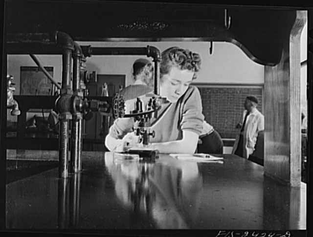 Miss Corine Grey from Glen Mills, Iowa in a bacteriology class. She is a senior and majoring in Bacteriology. Iowa State College. Ames, Iowa