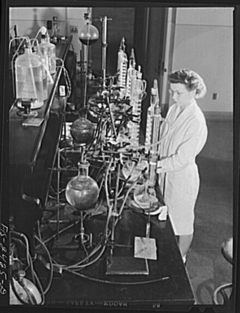 Miss Jeanne Dougherty, graduate in Bacteriology, working in the laboratory in the Dairy Industry Department. She is conducting experiments on the effect of acids on the flavor of butter. Iowa State College. Ames, Iowa