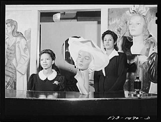 Miss Minnie Coleman (left), clerk, and Miss Selma Barbour (right), manager of the Cecilian Specialty Hat Shop. 454 East 47th Street, Chicago, Illinois