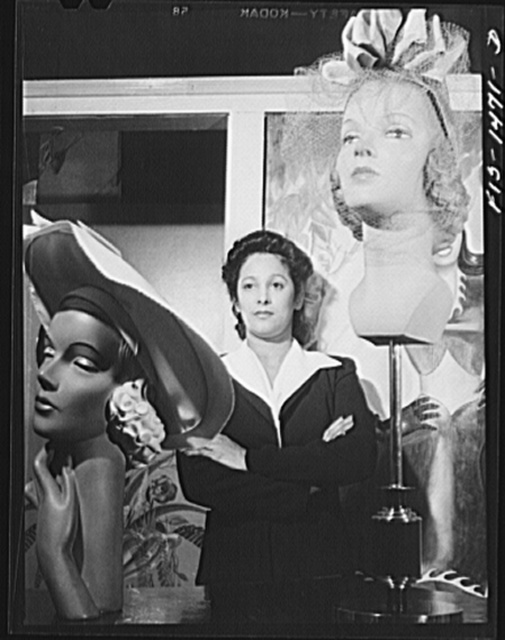 Miss Selma Barbour, manager of the Cecilian Specialty Hat Shop, 454 East 47th Street. Miss Barbour has been managing this store for one year, and has been in business for four years. She was born in New Orleans, and has eight brothers, seven of whom are eligible for the Army. Chicago, Illinois