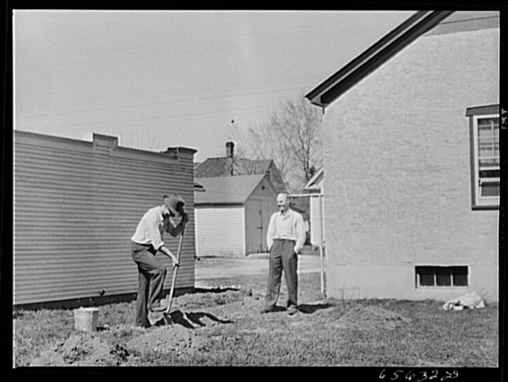 Missoula, Montana. Digging up ground for backyard garden