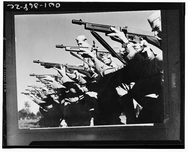 Mitchel Field, New York. On the rifle range members of the airbase squadron learn to fire the snubnose Thompson sub-machine gun. The highest degree of proficiency in the use of these firearms is attained in the intensive training program