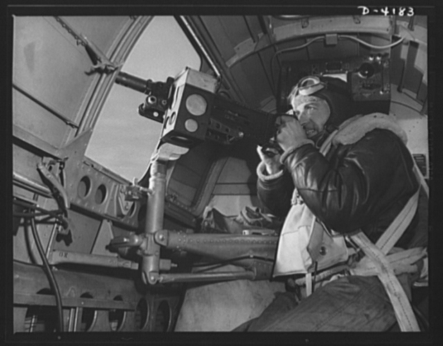 Mitchell Field. The side gun of an American bomber gets plenty of work during an air battle. Manned by a brave, able, well-equipped gunner, it's one of the tools that is steadily thinning out Japanazi air power