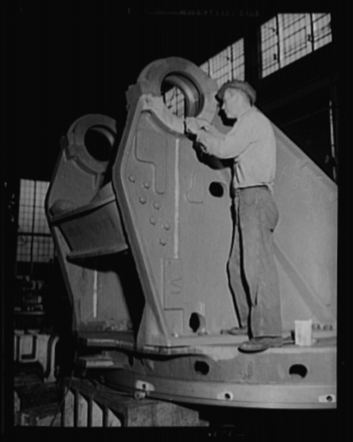 Mobile defender. A big piece for a railway gun is polished up. Worker at an eastern arsenal, engages in a finishing operation on the trunnion bearing ring for an 8-inch gun railway carriage