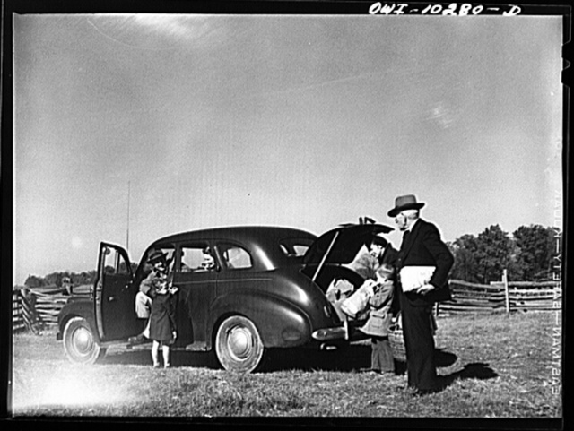 Montgomery County, Maryland. Farmers sharing a car on market day