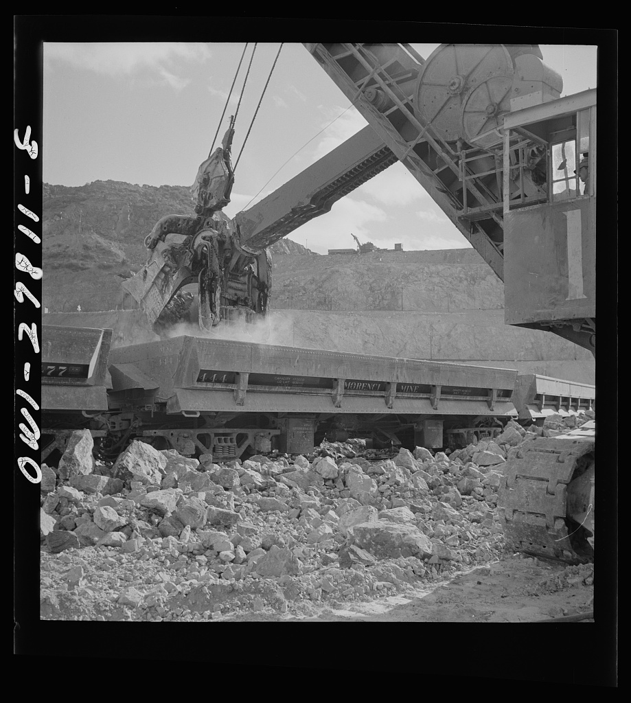 Morenci, Arizona. A huge electric shovel at an open-pit copper mine loading an ore train on its way to the smelter plant of the Phelps Dodge mining corporation