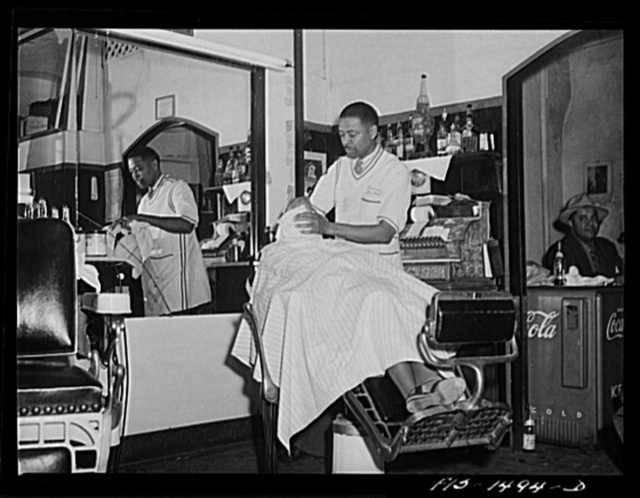 Mr. Oscar J. Freeman, barber, owns the Metropolitan Barber Shop, 4654 South Parkway, Chicago, Illinois. Mr. Freeman has been in business for fourteen years