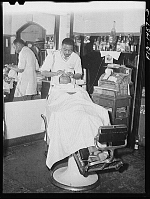 Mr. Oscar J. Freeman, barber, owns the Metropolitan Barber Shop, 4654 South Parkway, Chicago, Illinois. He has been in business fourteen years