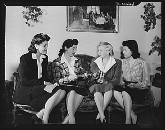 Mrs. Blossom Kaplitt, of Ocean Parkway, Brooklyn, New York (second from left) explains to Brooklyn housewives, whom she has enlisted in tin can salvage drive, how to prepare collected tin cans for the Department of Sanitation trucks. Since March 15th, she has organized twenty-five large apartment houses in the Borough Park section into units for salvage work. In each house a squad of three women, tenants in the apartment, collect once weekly from every housewife, tin cans accumulated during the previous week. In the cellar, each squad processes the cans, removes labels and bottoms, flattens them and deposits them into ashcans and barrels for pickup by department of sanitation trucks. Today twenty-five tons of empty processed cans have been collected through the efforts of Mrs. Kaplitt and other housewives in the territory across the East River. Left to right: Mrs. T. Cohen, Mrs. B. Kaplitt, Mrs. H. Mars, Mrs. T. Rubins