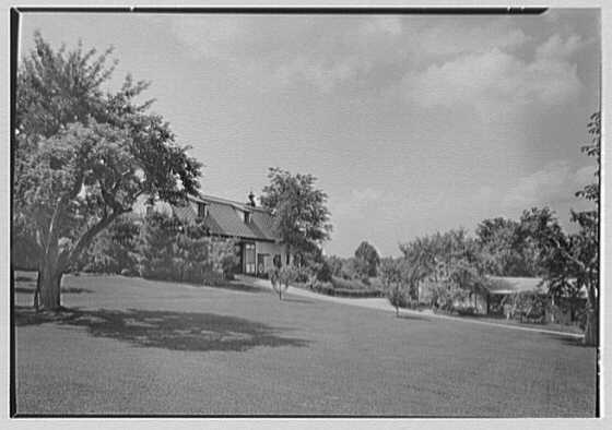 Mrs. Charles R. Moeser, Furlough Farm, residence in Bedford Hills, New York. Barn and stables