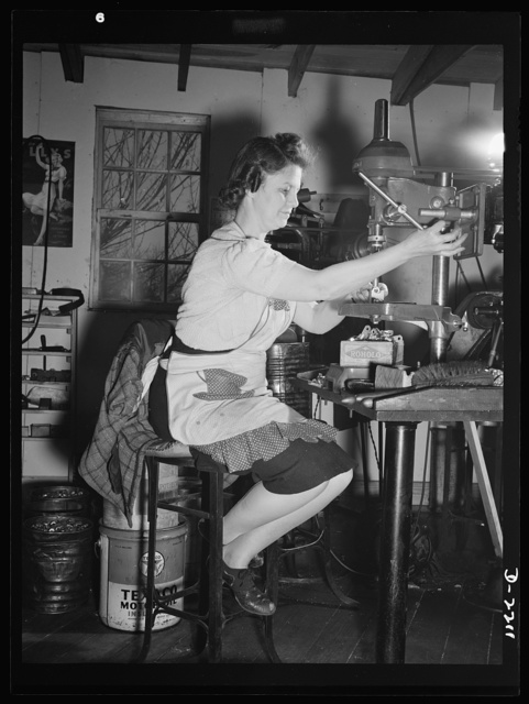 Mrs. Hazel Wheeler places screws into electric terminals. Mrs. Wheeler who lives in Bantam with her husband, a machinist at the Warren MacArthur Plant there, was in a happy state of mind when this picture was taken. She had just learned definitely that all was well with her son, attached to a naval medical unit at Pearl Harbor during the December 7 attack
