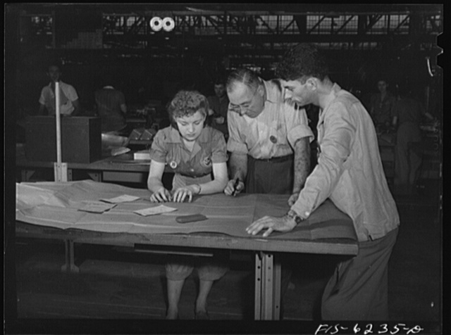 Nashville Tennessee. Discussing blueprints in the parts division. Vultee Aircraft Corporation plant