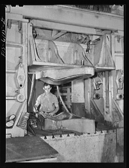 Nashville, Tennessee. Drop hammer operator stamping out parts for Vultee bombers
