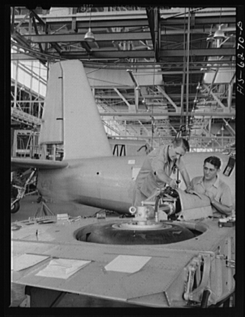Nashville, Tennessee. Installing landing gears in wing section. Vultee Aircraft Corporation plant