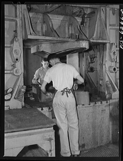 Nashville, Tennessee. Stamping out fuselage parts with a drop hammer. Vultee Aircraft Corporation plant