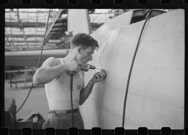 Nashville, Tennessee. Vultee Aircraft Company. Drilling holes for rivets in a fuselage on a sub-assembly line