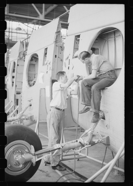 Nashville, Tennessee. Vultee Aircraft Company. Installing landing gear on wing parts in a sub-assembly section
