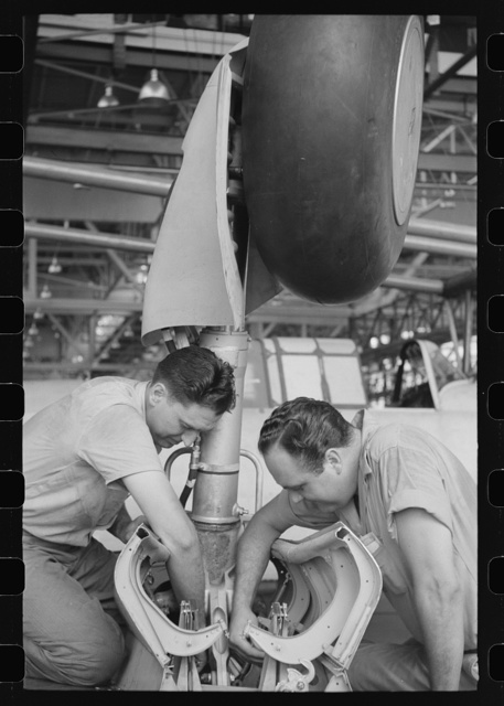 Nashville, Tennessee. Vultee Aircraft Company. Working on the landing gear of a bomber