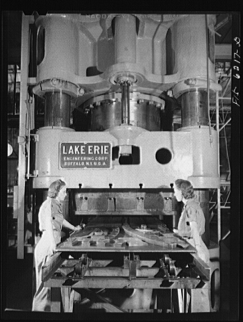 Nashville, Tennessee. Women operating a giant stamping machine. Vultee Aircraft Corporation plant